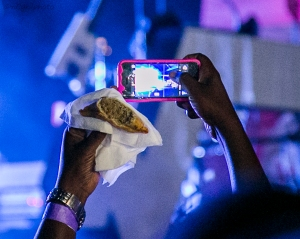 Stromae in Kigali Oct 17,2015 Samosa+Snapping the concert away= How cool is that! By Cyril